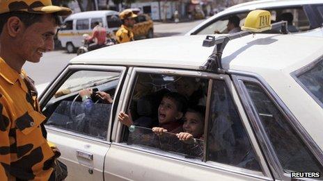 Policeman checks a taxi at a checkpoint in Sanaa 08/08/2013