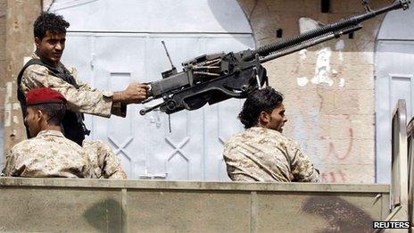 Soldier mans an anti-aircraft gun on a military vehicle patrolling Sanaa 08/08/2013
