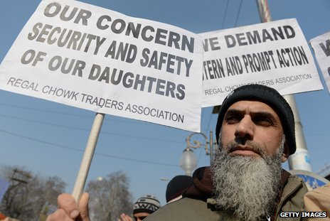 "A Kashmiri man hold a protest placard saying: ""Our concern - security and safety of our daughters"""