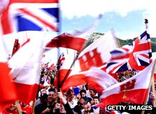 Gibraltar residents hold British flags