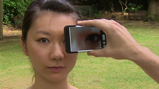 Phone being held up to a woman's eye