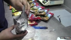 police searching food packets