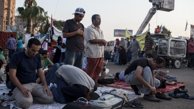 Supporters of deposed Egyptian President Mohammed Morsi perform morning prayer