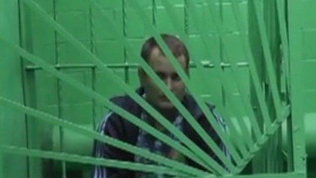 Surgeon in custody in Krasnoyarsk (garb from police video)