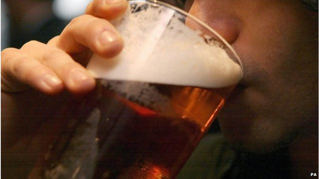 Man drinks pint of ale