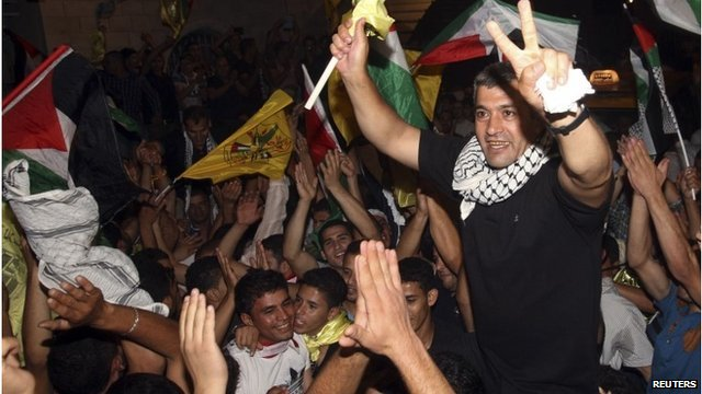 Freed Palestinian prisoner Mohammad Sawalaha is greeted by relatives and friends