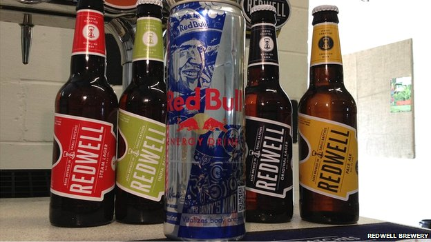 Redwell beer and Red Bull can