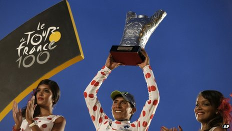 Nairo Quintana wearing the best climber's dotted jersey celebrates on the podium of the 100th edition of the Tour de France on 21 July, 2013.