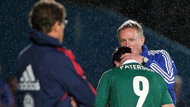 Michael O'Neill hugs goalscorer Martin Paterson