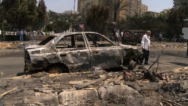 Burnt-out car at Rabaa al-Adawiya