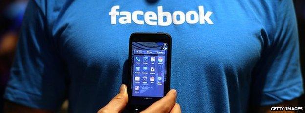 Facebook t-shirt and phone