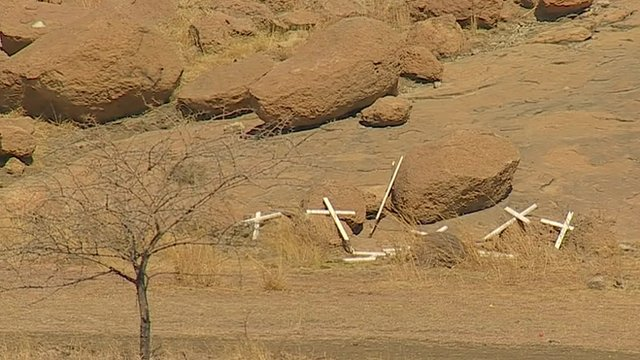 Broken crosses at the site of the Marikana shootings