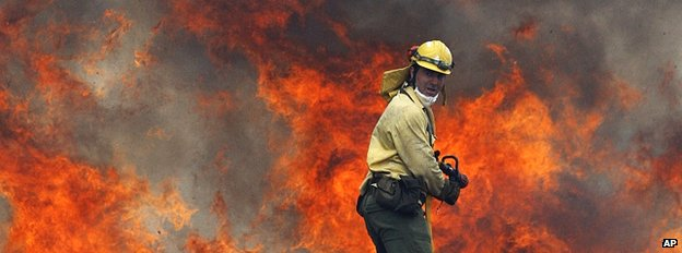 Firefighter tackling a wildfire in Spain (Image: AP)