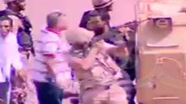 Security forces aiming gun