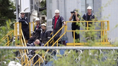 Workers gather at the drilling site