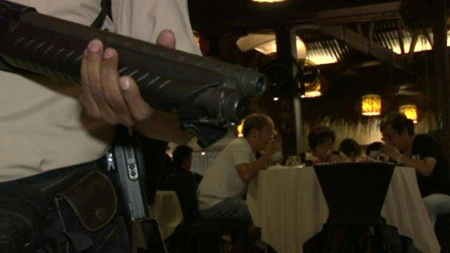 Armed guard at restaurant