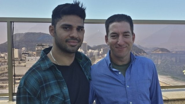 In this undated photo released by Janine Gibson of The Guardian, Guardian journalist Glenn Greenwald, right, and his partner David Miranda, are shown together at an unknown location