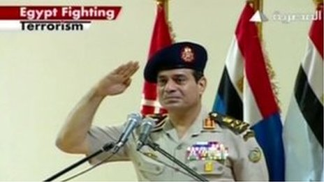 """Image from one of Egypt's main state TV stations, showing a new English-language logo - """"Egypt fighting terrorism"""" - in the corner"""