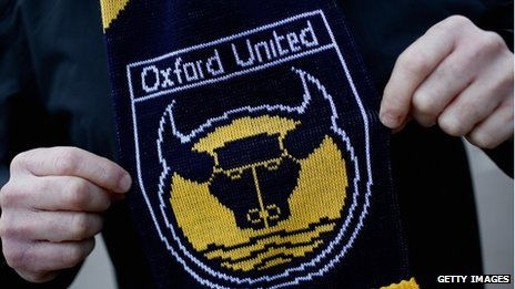 Oxford United supporter proudly displays his club scarf