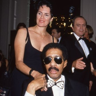 Richard Pryor with wife number four and seven, Jennifer Lee. Bob Newhart is in the background