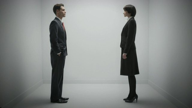 Man and woman in suits