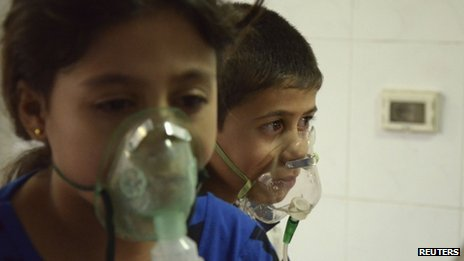 Children, affected by what activists say was a gas attack, breathe through oxygen masks in the Damascus suburb of Saqba on 21 August 2013