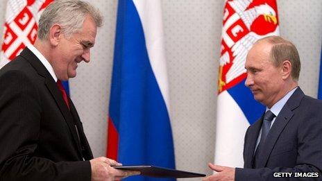 Tomislav Nikolic and Vladimir Putin exchanging documents in May 2013