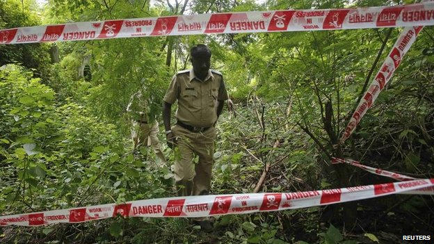 Policemen on 23 August 2013 survey the crime scene where a photojournalist was raped inside an abandoned textile mill in Mumbai