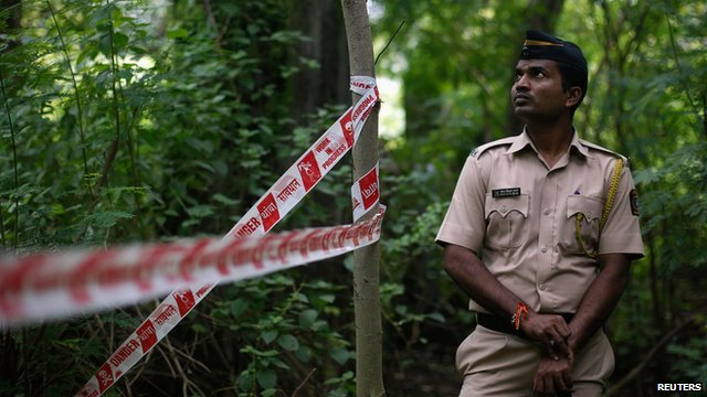 Policeman standing guard at crime scene