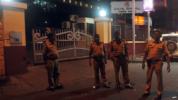 Policemen stand at the entrance gate to the city hospital where the gang rape victim is admitted, in Mumbai early morning on August 23, 2013