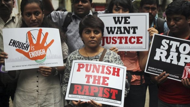 Photojournalists hold placards as they protest against the gang rape of a 22-year-old woman photojournalist in Mumbai India, Friday, Aug 23, 2013.