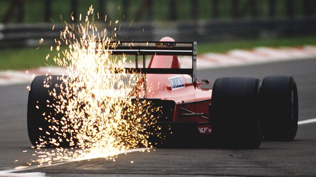 Sparks fly from the rear of Gerhard Berger's Ferrari