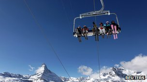 File photo of skiers in Switzerland in 2011