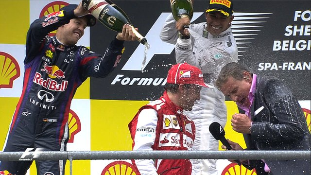David Coulthard is soaked in champagne by Sebastian Vettel and Lewis Hamilton.