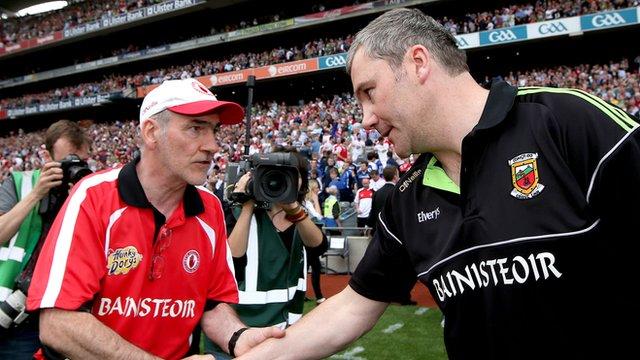 Tyrone's Mickey Harte congratulates James Horan at the end of the All Ireland semi-final