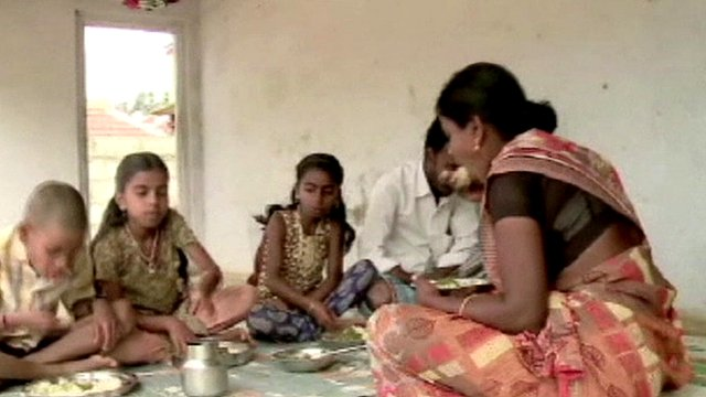 Family having a meal in India