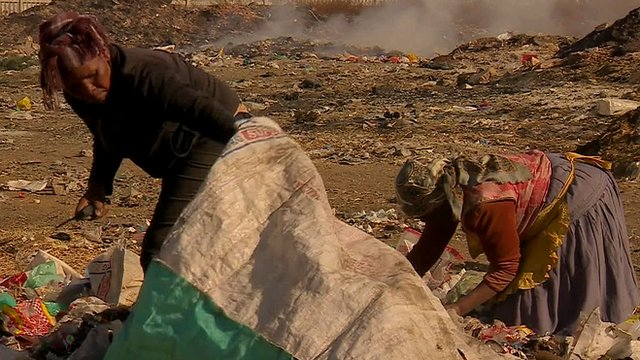 People scavenging on rubbish dump