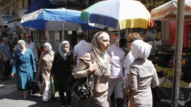 Syrians shop at al-Shaalan market in Damascus August 28, 2013