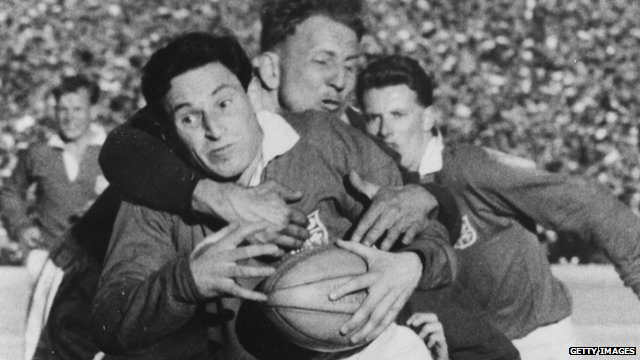 Cliff Morgan is tackled by Koch whilst playing for the British Lions against South Africa