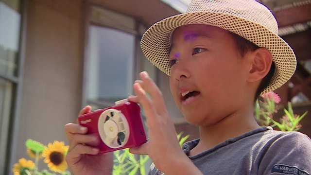 Child with Bigshot camera