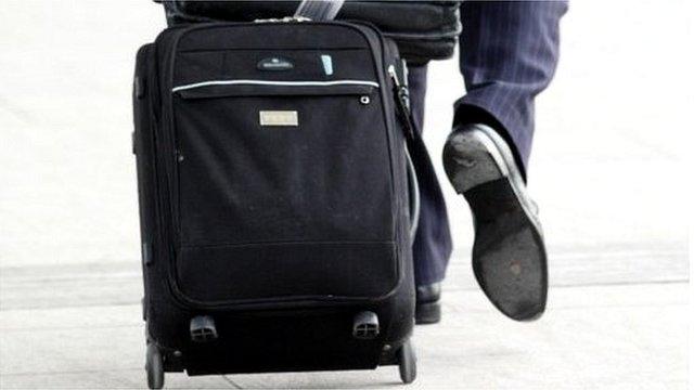Man pulls suitcase