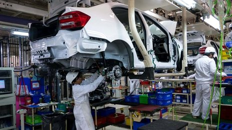 Two workers in a Honda car factory in Thailand