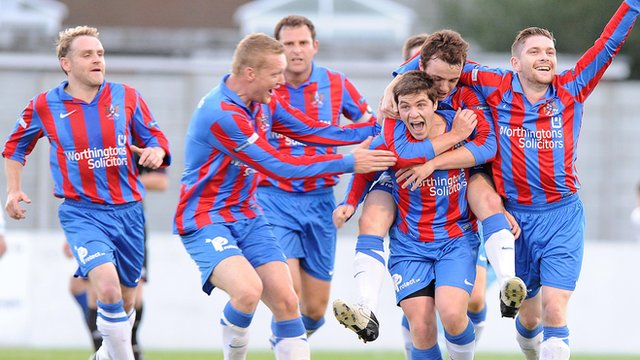 Ards players celebrate victory over Ballymena United
