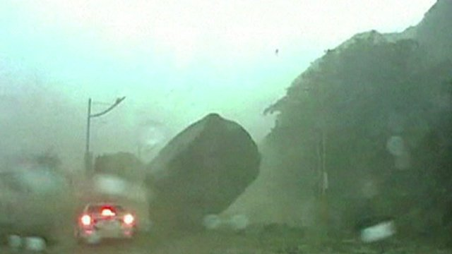 Giant boulder lands near car
