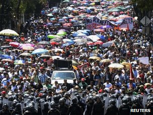 Protesters march through Mexico City September 1, 2013