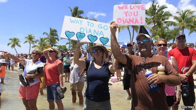 Supporters of Diana Nyad watch her complete her swim in Key West, Florida on 2 September 2013