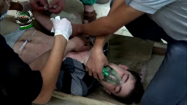 Man wears oxygen mask in still from amateur footage