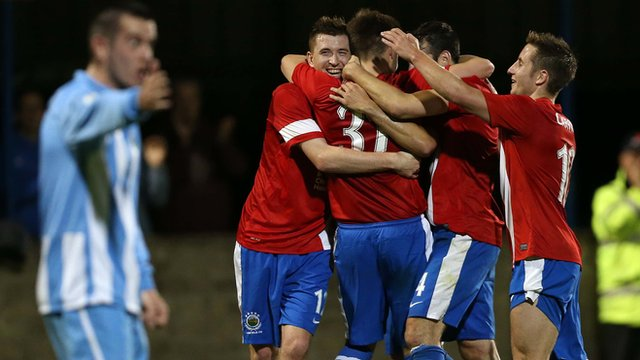 Linfield celebrated a 2-0 win over Warrenpoint Town
