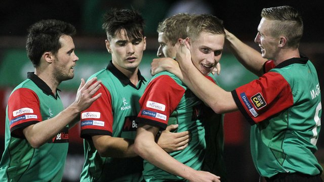Glentoran players celebrate victory over Ards at The Oval