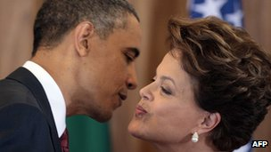 US President Barack Obama and Brazilian President Dilma Rousseff greet each other during a joint press conference in Brasilia on 19 March 2011